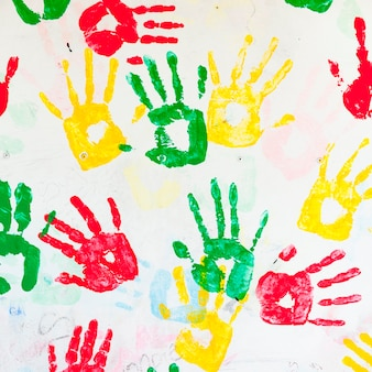Close-up of colorful hand prints on a wall, guatemala city, guatemala