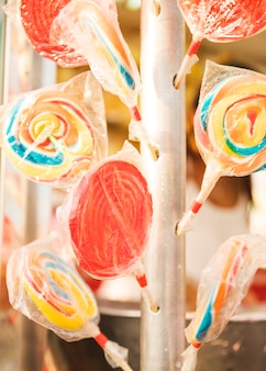 Close-up of colorful lollipops in plastic wrappers