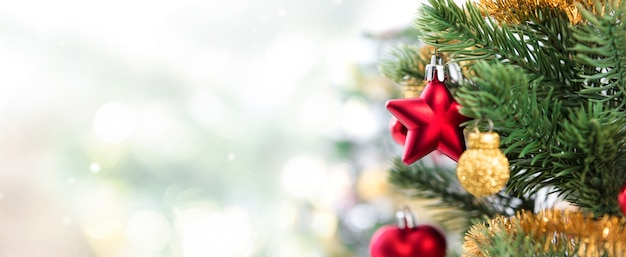 Close up of colorful ornaments on christmas tree, panoramic banner background