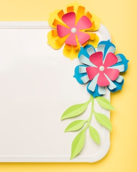 Close-up of colorful paper flowers on whiteboard