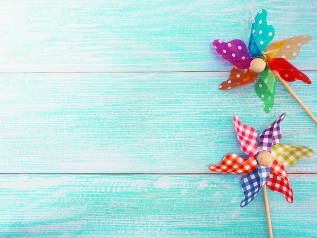 Close up colorful pinwheel over blue wood background