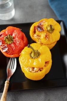Close up of colorful stuffed veggie peppers with rice and chickpea