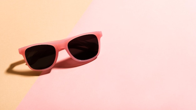 Close-up colorful sunglasses with shadow