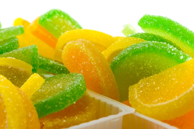 Close-up of colourful fruit candies over white