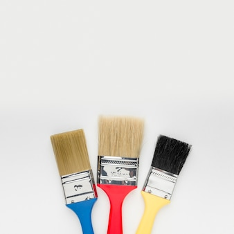 Close-up colourful paint brushes with copy space