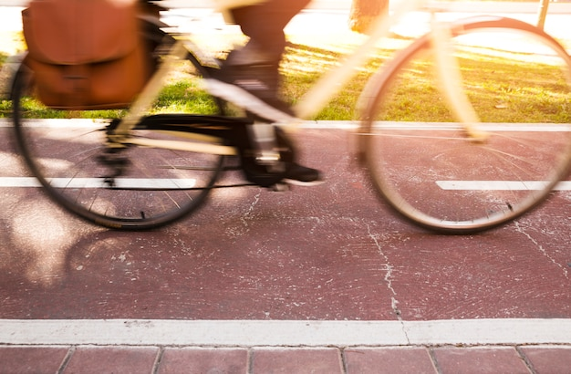 Close-up of a commuter riding the bicycle