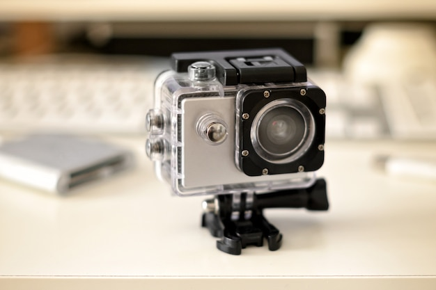 Close up on a compact rugged action camera on a mount for recording immersive action in video and photography