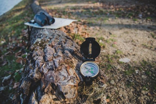 Close-up of compass on a fallen log
