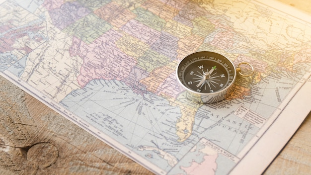 Close up compass on north america map
