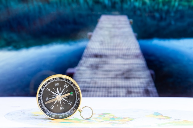 Close up compass on paper map, travel and lifestyle, manage to success business technology concept.