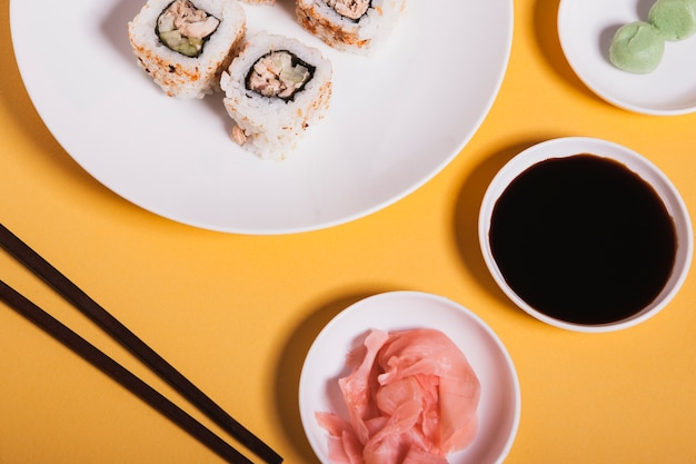 Close-up condiments near sushi