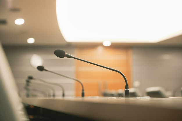 Close up the conference microphone on the meeting table or board room.