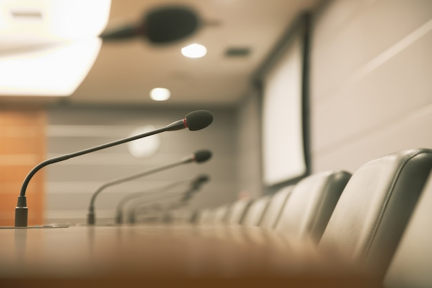 Close up the conference microphone on the meeting table