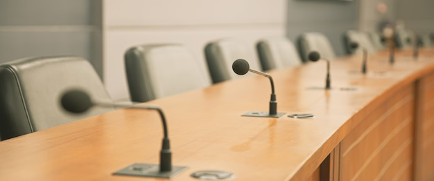 Close up the conference microphone on the meeting table.