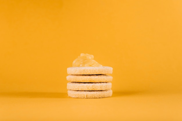 Close-up of cookies with lemon curd on yellow background