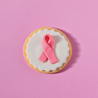 Close up cookies with pink ribbon