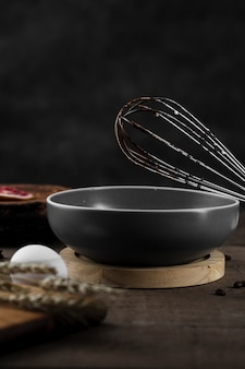Close-up cooking pan with whisk on the table