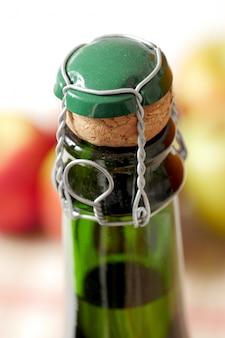 Close-up of the cork of cider bottle