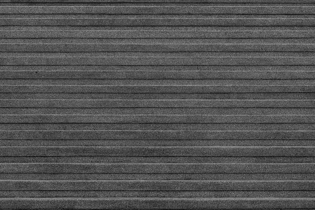 검은 돌 계단의 야외 대리석 계단 질감의 근접 코너.