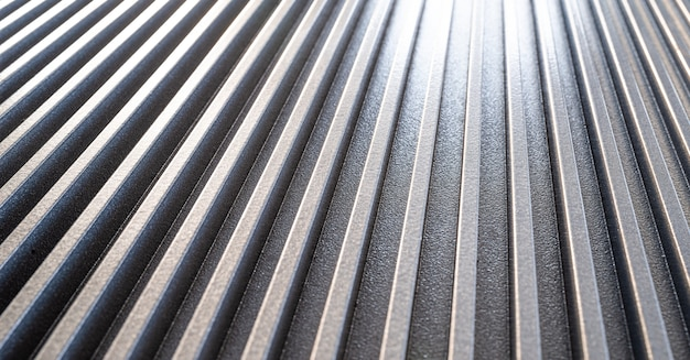 Close-up of a corrugated metal surface of unidentified military equipment