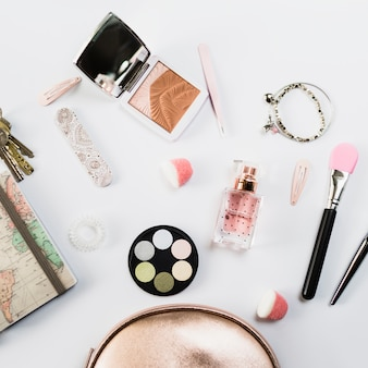 Close-up cosmetics near cute makeup bag