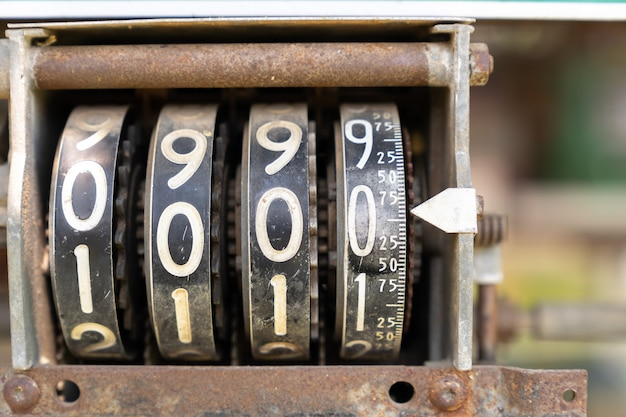 Close up counter analog number meter on vintage oil machine