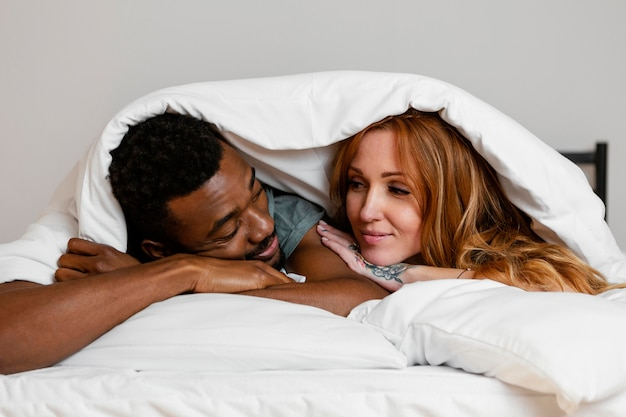 Close-up couple under blanket