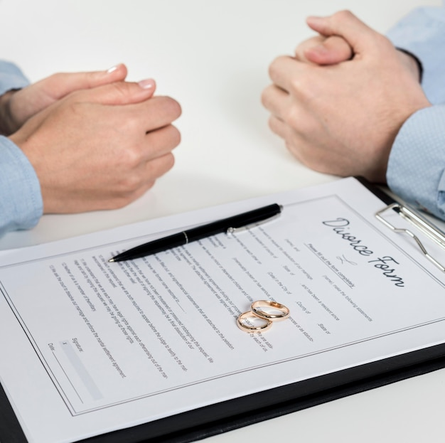 Close-up couple discussing divorce form