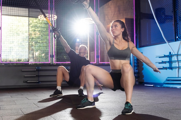 Close up on couple doing crossfit workout