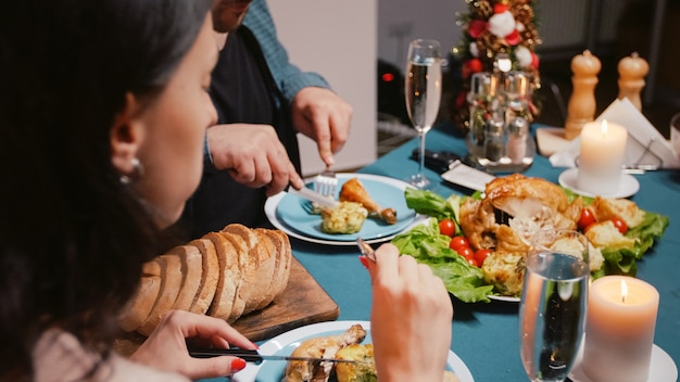 Close up of couple enjoying festive dinner with meal and alcohol