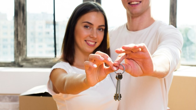 Close up couple holding keys