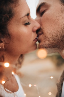 Close-up couple kissing outdoors