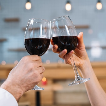 Close-up of couple making a toast