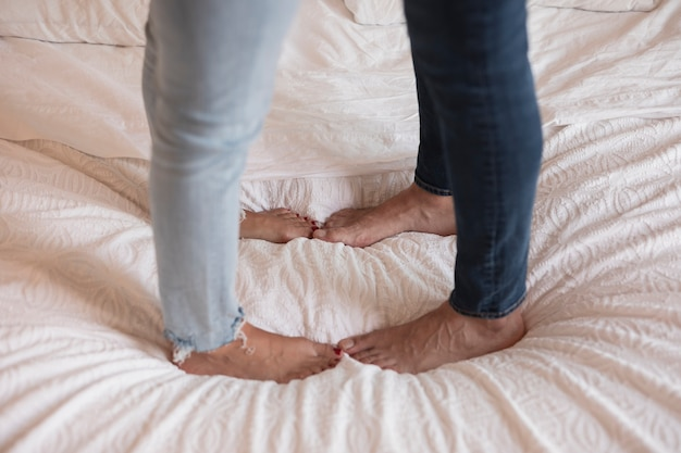 Close up of couple's feet on bed
