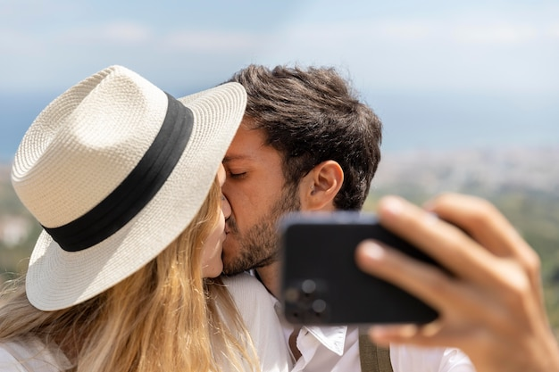 Close up couple taking selfies