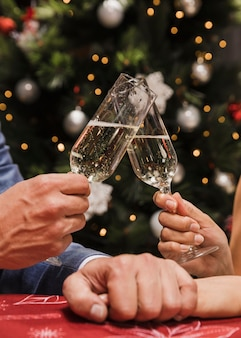 Close-up couple toasting champagne glasses