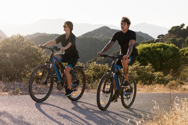 Close up on couple with electric bikes