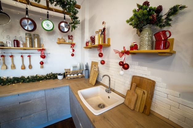 Close-up of a cozy modern kitchen for a large family, decorated for the new year celebration....