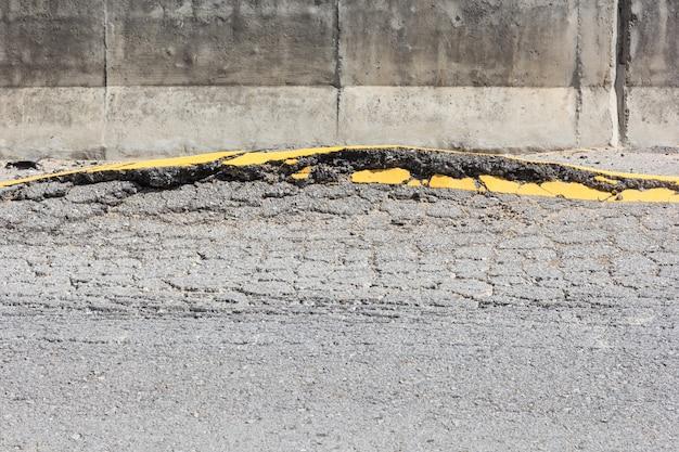 Close up of cracked asphalt road