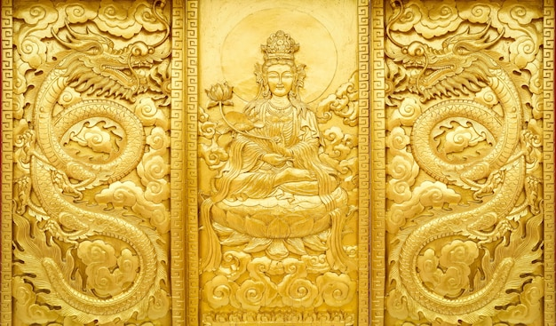 Close up craft wooden with gold color of guan yin china god