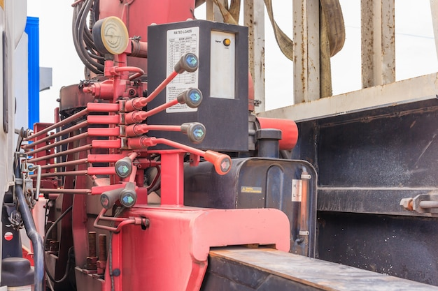 Close up of crane truck hydraulic control. mechanical levers of switching on control panel