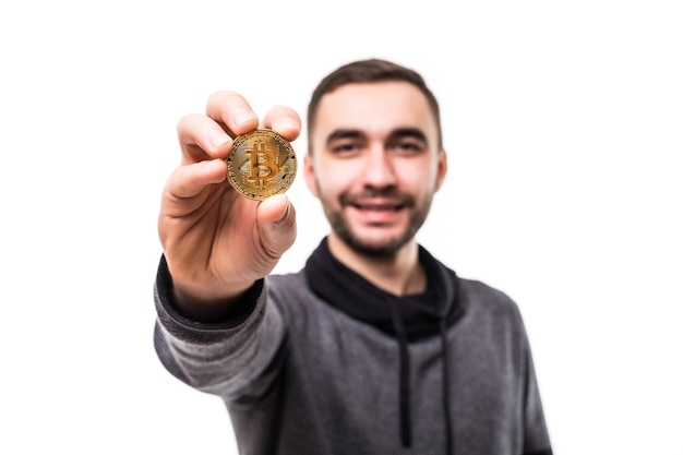Close up of a crazy man with bitcoins in his eyes pointing fingers isolated