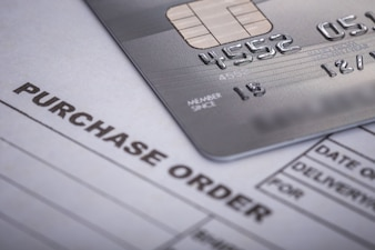 Close up credit card on purchase order in the office. For financial or business use