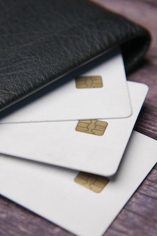 Close up of credit cards in a wallet on wooden background