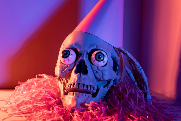 Close-up creepy halloween skeleton with confetti
