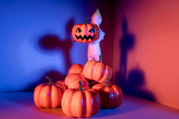 Close-up creepy halloween toys with pumpkins