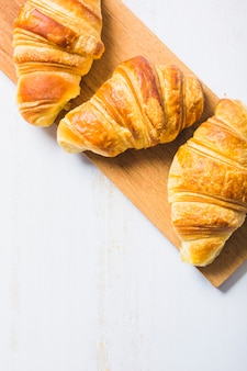 Close-up croissants on board