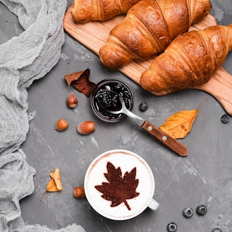 Close-up of croissants, jam and coffee