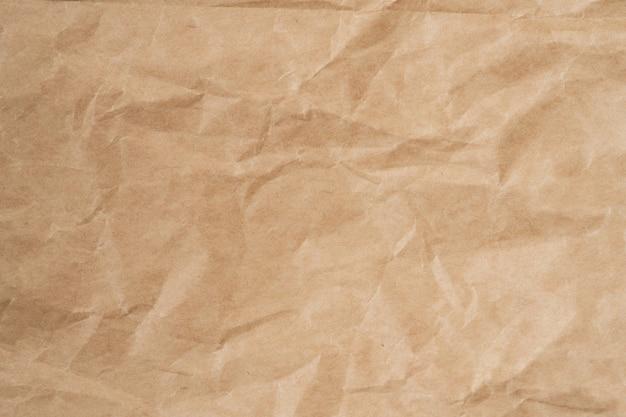 구겨진 갈색 종이 텍스처와 배경 복사 공간을 닫습니다