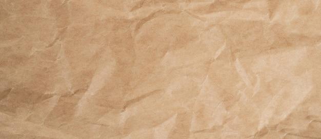 しわくちゃの茶色の紙のテクスチャと背景をコピースペースでクローズアップ